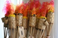Survivor torches - I used metallic gold & red paper twist, cut the tops into points, stapled together & just tucked in!