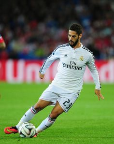 Real Madrid player Isco in action during the UEFA Super Cup match between Real Madrid and Sevilla FC at Cardiff City Stadium on August 12, 2014 in Cardiff, Wales.