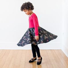 Watch out! Fierce, beautiful dragons circle this print, breathing fire of scarlet and sparkling gold. Your awesome girl will always be in control of these beasts, commanding them to fly - wings outspr