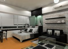 bedrooms comfortable modern bedrom design for men with white bed sheet with square black pillows and white wall with black open shelves and also black sofa with white throw pillows comfortable bedroom