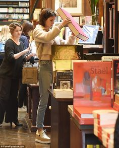 Big spender: Kendall Jenner, 19, spent some of her hard-earned pennies as she took to a Parisian bookstore for a shopping spree on Monday