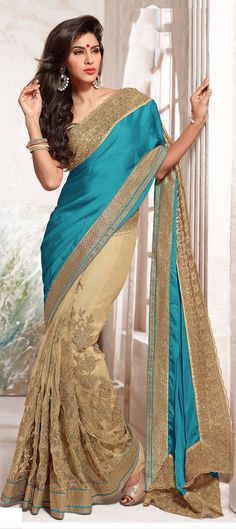 166860: Blue, Beige and Brown color family Saree with matching unstitched blouse.