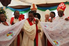 """Rev. Elfriede Katjizumo and Southern African delegates receive the """"Marangu Banner"""", symbolizing the journey to the 2017 Assembly in Windheok, Namibia Photo: LWF/Allison Westerhoff"""