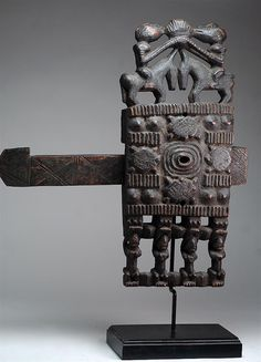 Africa | Door lock from the Dogon people of Mali | Wood, encrusted patina | ca. early 20th century
