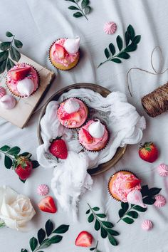 White Cake, Pink Frosting and fresh strawberries + Meringe Kisses Recipe…