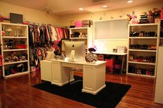 room closet. vanity in center. bookshelves for shoes. clothes racks