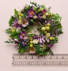 Sunny Yellow Miniature Wreath with a Bounty of Blooms - some of the leaves look like they come from pressed flower embellishments
