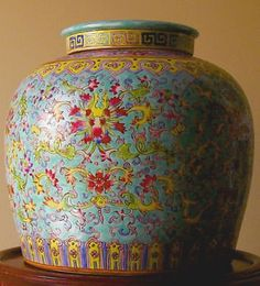 The ginger jars I have tend to have rounded lids, more of a teal-green colour and the flowers are a lighter pink. I would looove to find one like this!