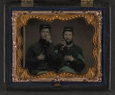 [Two unidentified soldiers in Union uniforms holding cigars in each others' mouths] (LOC) by The Library of Congress, via Flickr