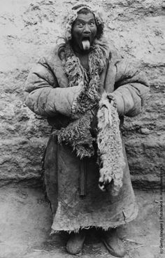 A Tibetan man from Lhasa sticking out his tongue, a traditional method of greeting