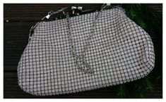 Modern mesh op shop find - a beige Natio branded small clutch bag purchased for $3.00.