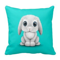 Cute White Baby Bunny Rabbit on Blue Pillow great for a baby nursery or kid's room.