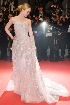 20 May Elle Fanning opted for a fairytale Zuhair Murad gown with floral appliqué.   - HarpersBAZAAR.co.uk