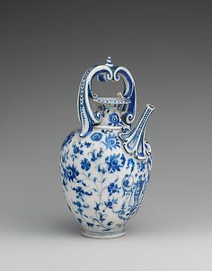 "'Ewer' c. 1575–87 Italy, Soft-paste porcelain. ""Porcelain was first produced in Europe in Florence under the patronage of Francesco de Medici, grand duke of Tuscany (r. 1574–87). This ewer, one of only fifty-seven known pieces of so-called Medici porcelain, combines numerous influences: the form is related to goldsmiths' work and to majolica, the blue-and-white scheme is Chinese, and the floral decoration is borrowed from Isnik pottery."""