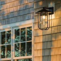 The Erlenmeyer Large Outdoor Sconce by Hubbardton Forge is a tribute to nautical lanterns found throughout New England. A sturdy metal cage protects the thick glass flask. Available in your choice of Coastal Outdoor Finishes, this versatile sconce welcomes you with an updated look on a design classic. #outdoorlighting #outdoorliving #coastalfinish #lightingdesign #designinspiration #lightingdesigners @westphalenphotography Outdoor Barn Lighting, Outdoor Wall Lantern, Outdoor Wall Sconce, Outdoor Walls, Nautical Lanterns, Glass Flask, Nelson Bubble Lamp, Dark Smoke, Glass Shades