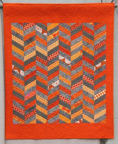 LOVE this bright orange and gray quilt!   Caltrans Quilt Made and Quilted by Susan Kephart
