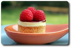 Mini Cheesecake Tarts - a crisp, almond-laced crust, topped with vanilla cheesecake, raspberry jam and a trio of fresh berries