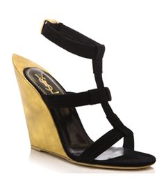 Totem Wedges by Yves Saint Laurent. Black. Leather. Open toe. Single front strap. Black leather and silver metal stiff ankle strap with press down buttoned fastening. Black block mid high heel. #Matchesfashion