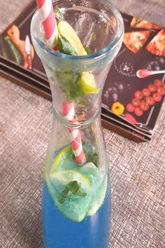 """""""If more of us valued food and cheer and song above hoarded golYou can find Virgin mojito and more on our website.""""If more of us valued fo. Virgin Mojito, Hurricane Glass, Cheer, Glass Vase, Indoor, Songs, Canning, Website, Drinks"""