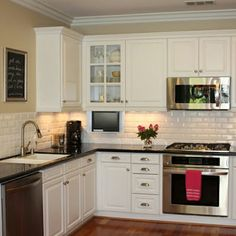 White Kitchen Black Countertop this is it!!! white cabinets, subway tile, quartz countertops