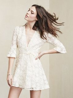 The Lianne Dress is just a little something to frolic around in. This is a textured lace wrap mini dress made from surplus cotton blend.