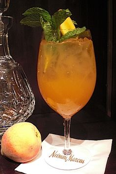 "Southern Lady. Recipe: Ice to fill glass,   1 1/2 oz. Maker's Mark, 2 oz. fresh lemonade, 2 oz. Dammann Freres iced tea, 1 oz.  peach marmalade.   Add ingredients into mixing glass, ""roll"" into another mixing glass 2 to 3 times and pour into a large wine glass. You may need to add a few more ice cubes.  Garnish with peach slice and mint sprig."