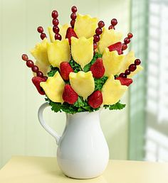 Pitcher Perfect Tulips http://www.posiesplansandpics.com/PageTemplates/ShoppingCart.aspx?PageID=133&ProductID=973630
