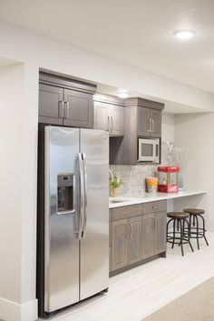 dark cabinets with white washed brick backsplash More