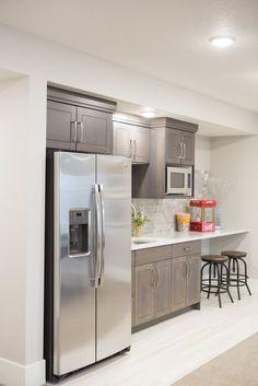 dark cabinets with white washed brick backsplash