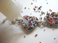 Resin envirotex DIY craft projects are gaining popularity again. Find easy and simple ways to use resin to craft small beginner projects at home. Paper Jewelry, Resin Jewelry, Jewelry Crafts, Handmade Jewelry, Candy Jewelry, Silver Jewellery, Jewelry Ideas, Diy Arts And Crafts, Diy Craft Projects