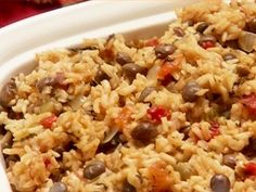 Pigeon Pea Rice: Arroz con Gandules recipe from Ingrid Hoffmann via Food Network Rice And Pigeon Peas, Rice And Peas, Carribean Food, Caribbean Recipes, Bahamian Peas And Rice Recipe, Arroz Con Gandules Recipe, Rice Recipes, Cooking Recipes, Yummy Recipes