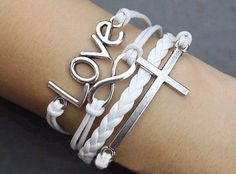 Silver infinity sideway cross charm on white braided leather n waxed chord bracelet.