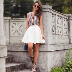 camila coelho in white skirt stripped top summer look