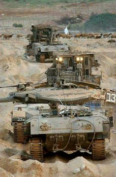 Israeli heavy armored personnel carrier Achzarit, tank Merkava and a bulldozer in the Gaza strip.