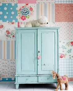 That wallpaper is DARLING, too overpowering for an entire room, but one wall and then the other in a pale pink or light aqua... perfect!