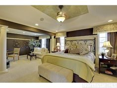 We love this gracious master suite with elegant columns, sitting area and beautiful patterned ceiling.