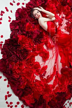 Dominique Nadine, Gorgeous artistic red floral roses flowers photo of woman in vibrant red fashion dress, colorful floral petals and flowers feminine romantic image