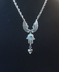 Mystical Necklace Heart  Hamsa Hand and by CocomotionalDesigns   A new necklace in my SpiritWear Collection