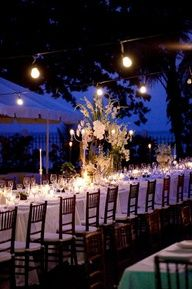 Outdoor wedding lighting -Purple background lighting and soft lighting at tables