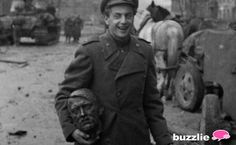 A Soviet soldier carrying Hitler's head, after capturing Berlin in 1945.