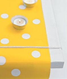 White-dot stickers from an office-supply store add a playful touch to the yellow table runner.