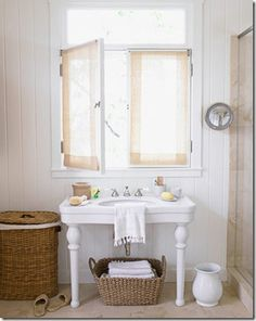 I love this bathroom sink and the use of wicker.