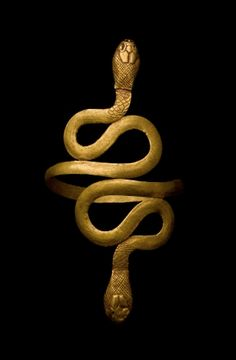 An Egyptian gold bracelet takes the shape of two coiled snakes, ancient Egypt.