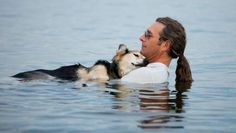 This gentleman takes his dog swimming for hours each day to help ease the dog's arthritis. The dog is so comfortable in the water that he often falls asleep.
