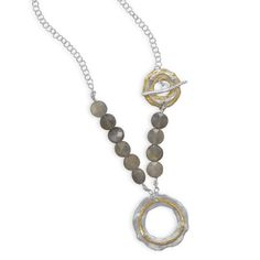 Sterling silver toggle necklace with brass accents and 10mm faceted labradorite stones. $149