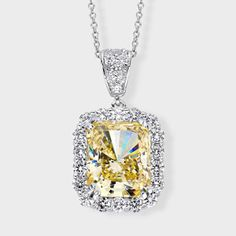 3.5 Ct. Radiant Cut  14K Fancy Pendant. Fancy cubic zirconia pendant features 3.5 carat radiant cut simulated yellow diamond surrounded by prong set round stones. An approximate 4.34 total carat weight, set in 14k white gold. An Italian cable chain is included, with your choice of 16 inch or 18 inch length. The pendant measures about 1 inch long (including the bail) and 0.50 inch wide. This high quality cubic zirconia pendant is also available in 14k yellow gold via special order.