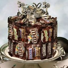 Mini candy bars glued to cake form with candles on top - super cute as a b-day gift!