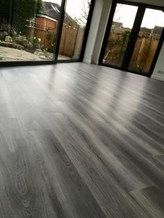 We are proud of the work we have done for our clients and would like to share these with you, to give you some further inspiration. Grey Wooden Floor, Wooden Floor Tiles, Wooden Flooring, Amtico Flooring Kitchen, Grey Laminate Flooring, Living Room Hardwood Floors, Bedroom Flooring, Grey Hardwood Floors, Home Room Design