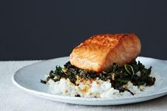 """Crispy coconut kale with roasted salmon and coconut rice: a dish that sounds like a mouthful but comes together in under an hour."""