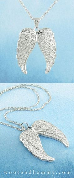 This dramatic pair of angel wings pendant shimmers all over with tiny crystals. Made of pure sterling silver and cubic zirconia.